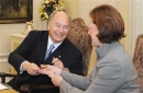 Alberta Premier Alison Redford trades pens with the Aga Khan after both signed an agreement of co-operation Wednesday at Governm